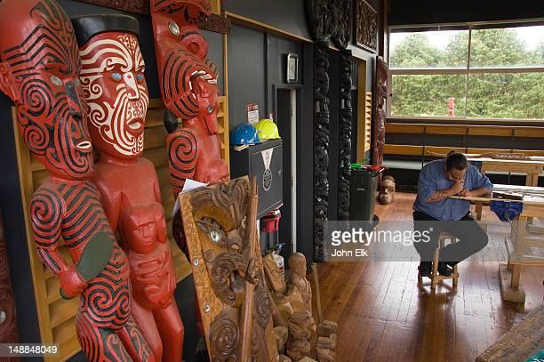 Maori woodcarver at work, Te Whakarewarewa.