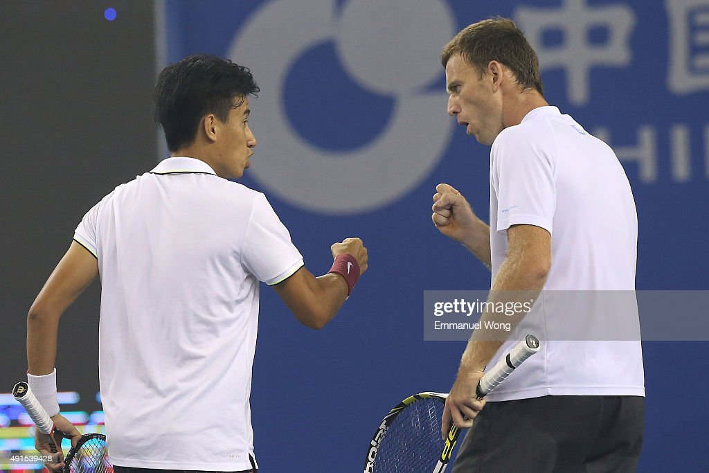 Mao-Xin Gong (L)of China and Michael Venus of New Zealand react during their double match against Novak Djokovic of Serbia and Djordje Djokovic of Serbia during the day four of the 2015 China Open at the China National Tennis Center on October 6, 2015 in Beijing, China.