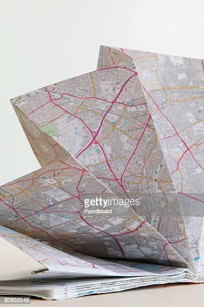 Map folded in fan shape, studio shot