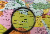 Map of Libya under a magnifying glass
