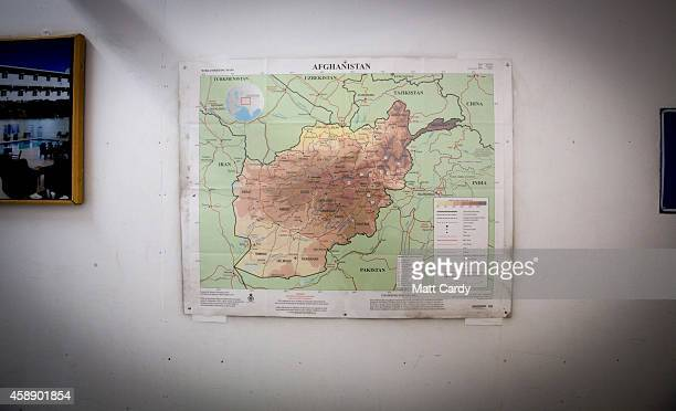 A map of Afghanistan is displayed in the airport terminal departure lounge at Kandahar airfield on November 13 2014 in Kandahar Afghanistan Now that...