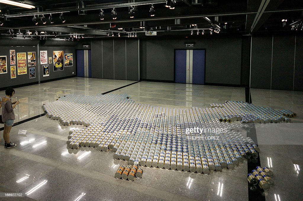 A map of China made from more than 1,800 cans of baby formula created by dissident Chinese artist Ai Weiwei is displayed in Hong Kong on May 17, 2013 reflecting the controversy over mainland demand for milk powder. A surge in demand for formula in China sparked by fears over the safety of domestic milk powder has seen shop shelves around the world cleared out by Chinese buyers and unofficial exporters. AFP PHOTO / Philippe Lopez CAPTION