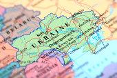 Map of green Ukraine on a globe