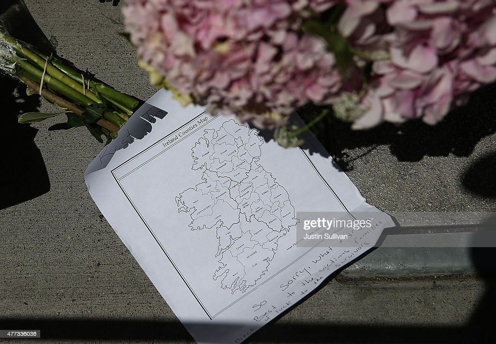 A map of Ireland sits in a memorial of flowers at the scene of a balcony collapse at an apartment building near UC Berkeley on June 16 2015 in...
