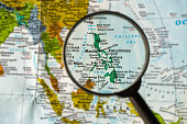 Map of Philippines through magnifying glass