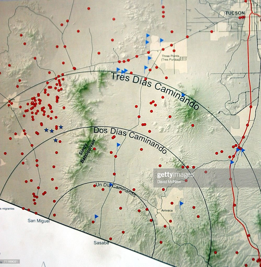 A map on the wall in the Mexican Red Cross mobile clinic shows how far immigrants can walk from the border at Sasabe with circles indicating one- ,two-, and three-day distances on June 6, 2006 in Altar Mexico, 60 miles south of the border village of Sasabe. Most immigrants walk for three days or more. The red dots indicate known sites of immigrant deaths, blue flags indicate water, and blue stars show where rescue beacons can be found. More illegal immigrants pass through Altar where immigrant smuggling is the primary industry, than any other town. Available services include 'coyotes' or guides, transportation over 60 miles or more of dirt road in vans carrying as many as 25 people, about 150 'hospedajes' or guest houses, provisions, a free mobile clinic catering mostly to people who were hurt trying to cross the border, and groups who warn immigrants on the dangers of the trek and help those in need. From here, most immigrants are guided through Sasabe, where nightly robberies have become an industry and rape is common, then across the US-Mexico border to walk for about 45 miles through the desert before being picked up by smuggler vehicles. It is during the walk that most of the 473 deaths of 2005 occurred, mostly from exposure to extreme heat and fatigue.