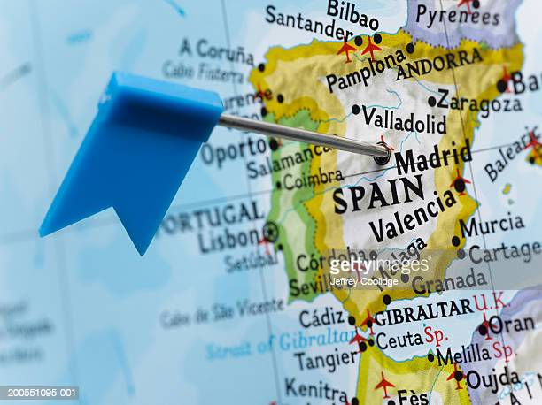 Map pin placed in Madrid, Spain on map, close-up