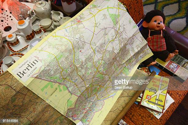 A map printed in the former communist East Germany or DDR and showing East Berlin but not West Berlin lies among items made in the DDR at the VEB...