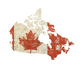 Canada map shaped old grunge vintage dirty faded shabby distressed Canadian flag with red maple leaf isolated on white background