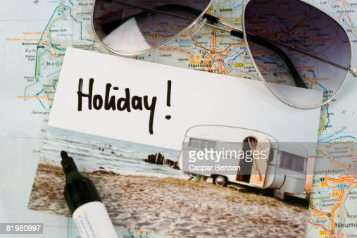 A map, sunglasses, and a postcard