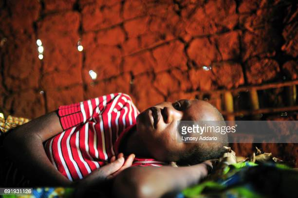Mapendo lies in her home in Burhale South Kivu weak and covered in a skin rash less than a year after she was kidnapped and raped by five men wearing...