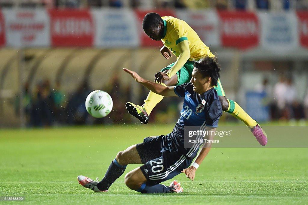 Maphosa Modiba of South Africa shoots at goal while Shinnosuke Nakatani of Japan tries to block during the U-23 international friendly match between Japan and South Africa at the Matsumotodaira Football Stadium on June 29, 2016 in Matsumoto, Nagano, Japan.