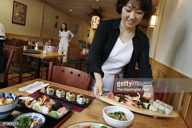 Maple Ave W Vienna VA Hyun Hee Han serves up the Deluxe Sushi platter top right at Kansai Sushi Authentic Japanese Restaurant in Vienna Virginia on...