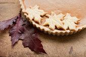 Maple leaf cookies on pumpkin pie