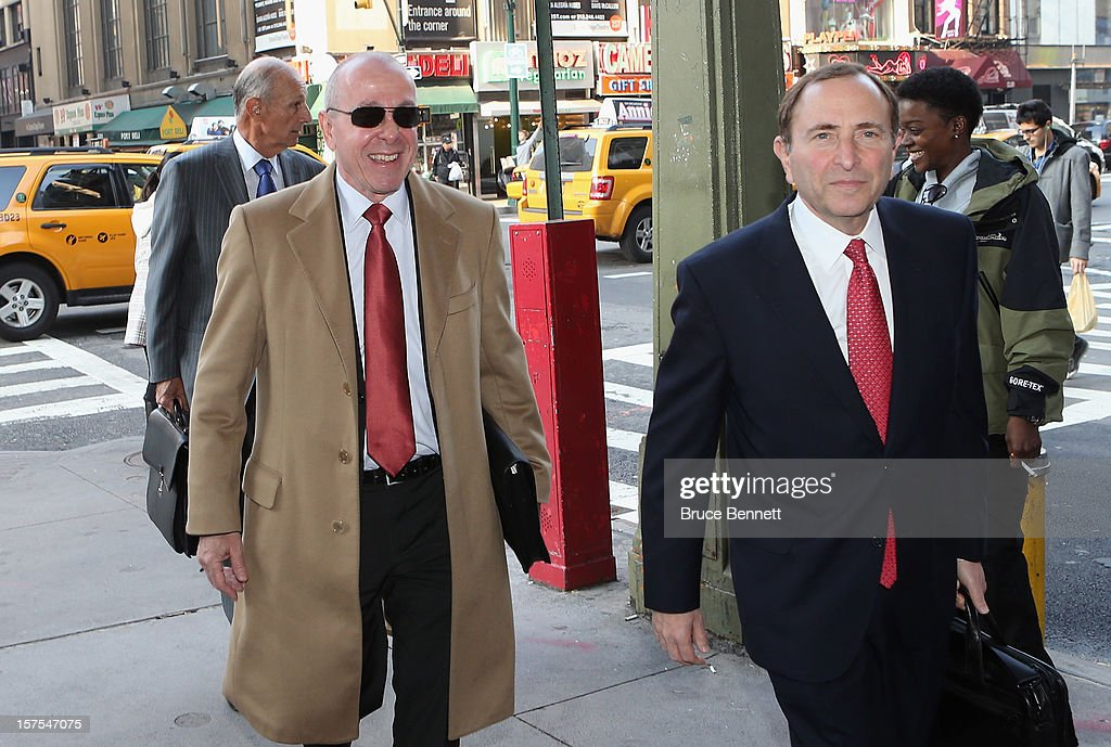 Maple Leaf Sports & Entertainment Chair Larry Tanenbaum and NHL Commissioner <a gi-track='captionPersonalityLinkClicked' href=/galleries/search?phrase=Gary+Bettman&family=editorial&specificpeople=215089 ng-click='$event.stopPropagation()'>Gary Bettman</a> arrive for a negotiation session with the NHL Players Association at the Westin Times Square Hotel on December 4, 2012 in New York City.