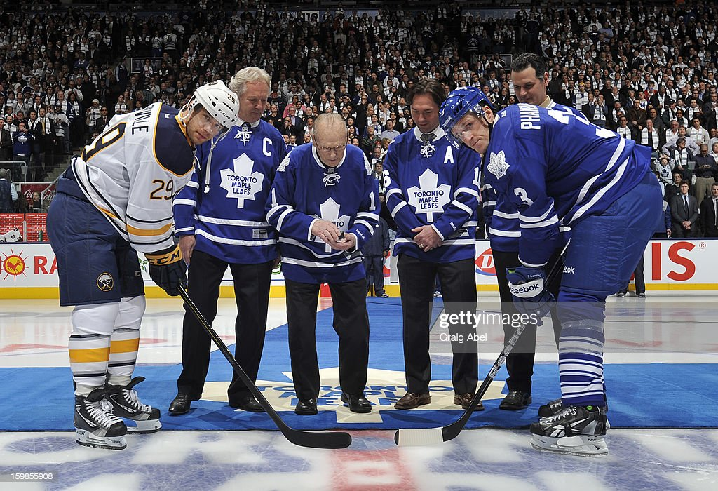 Maple Leafs Alumni Darryl Sittler, <a gi-track='captionPersonalityLinkClicked' href=/galleries/search?phrase=Johnny+Bower&family=editorial&specificpeople=239053 ng-click='$event.stopPropagation()'>Johnny Bower</a>, <a gi-track='captionPersonalityLinkClicked' href=/galleries/search?phrase=Darcy+Tucker+-+Ice+Hockey+Player&family=editorial&specificpeople=201928 ng-click='$event.stopPropagation()'>Darcy Tucker</a> and <a gi-track='captionPersonalityLinkClicked' href=/galleries/search?phrase=Felix+Potvin&family=editorial&specificpeople=203128 ng-click='$event.stopPropagation()'>Felix Potvin</a> take part in a ceremonial face off between Dion Phaneuf #3 of the Toronto Maple Leafs and Jason Pominville #29 of the Buffalo Sabres during NHL game action January 21, 2013 at the Air Canada Centre in Toronto, Ontario, Canada.