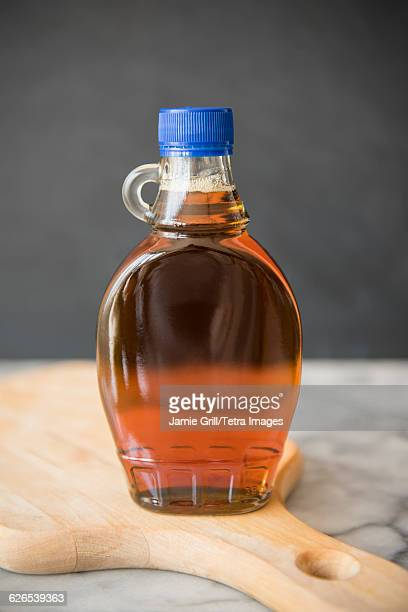 Maple syrup in bottle on cutting board