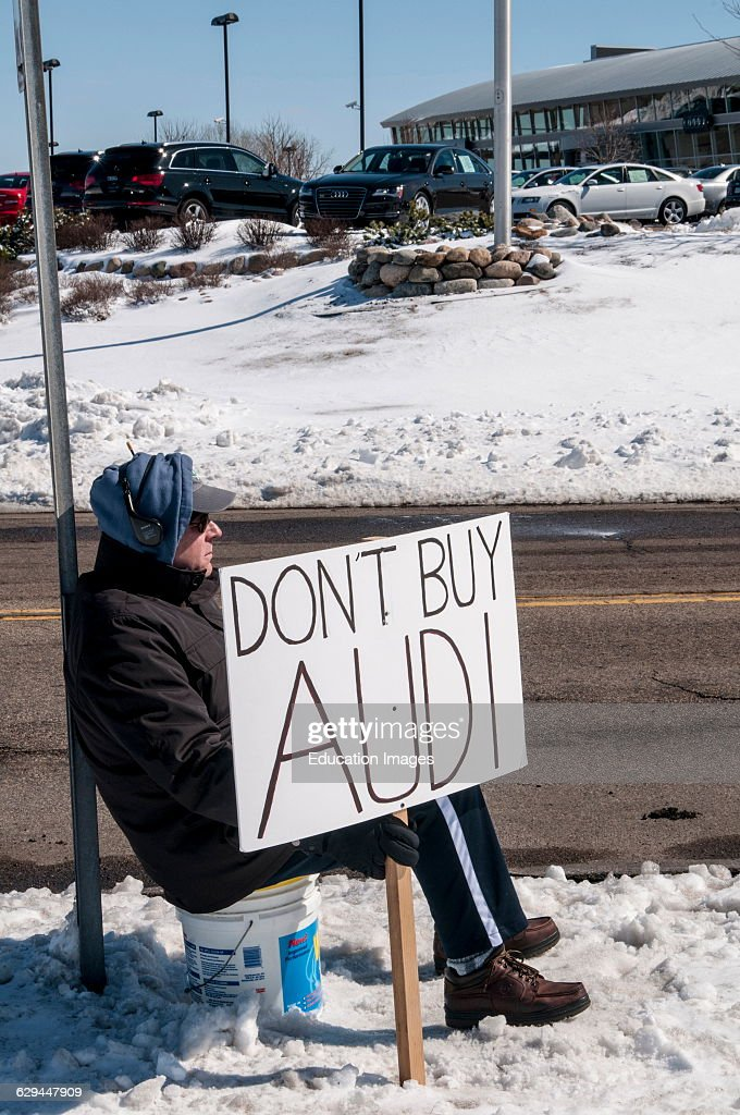 Maplewood Minnesota A man stages a protest in subfreezing weather in front of an Audi car dealership He is protesting Audi's refusal to fix his car