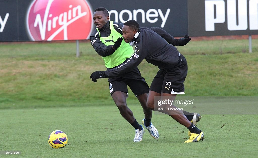 Mapou Yanga-Mbiwa (left) challenges Shola Ameobi during a Newcastle United training session at The Little Benton training ground on January 31, 2013 in Birmingham, England.