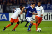 Mapou YangaMbiwa of Montpellier and Garry Bocaly challenge Julian Draxler of Schalke during the UEFA Champions League group B match between FC...