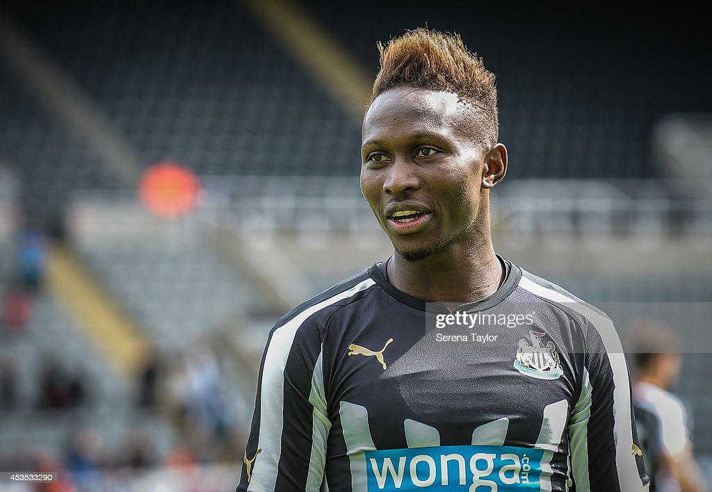 Mapou Yanga-Mbiwa smiles during a Newcastle United Training Session at St.James' Park on August 12, 2014, in Newcastle upon Tyne, England.