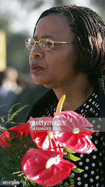 Graca Machel widow of founding president Samora Machel and wife of South African exPresident Nelson Mandela holds flowers at Heroes Place mausoleum...
