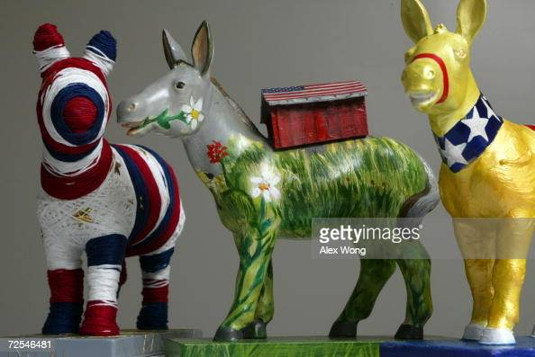Maquettes of donkeys the symbol of the Democratic Party from the Party Animals Project are displayed March 22 2002 in Washington DC One hundred pairs...