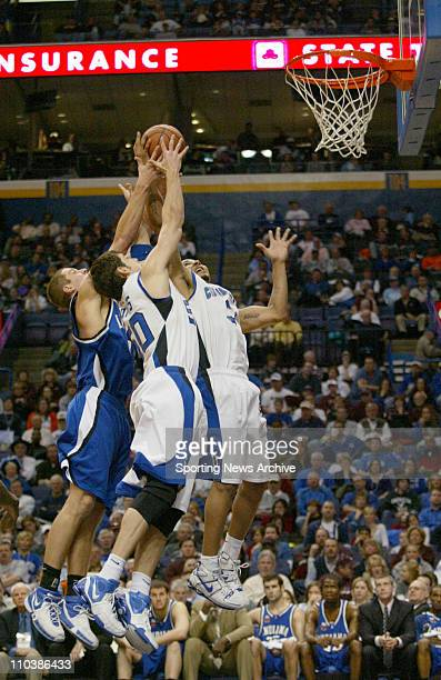 Mar 02 2007 St Louis MO USA Indiana State ADAM ARNOLD against Creighton NICK PORTER DANE WATTS during the Missouri Valley Conference Tournament at...