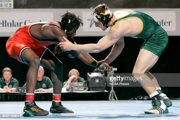 Romeo Djoumessi of Wartburg wrestles Delaware Valley's Michael Wilcox during the 2008 NCAA Division III Wrestling Championship at the US Cellular...