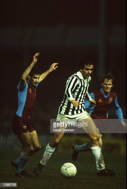 Michel Platini of Juventus is shadowed by Andy Blair of Aston Villa during the European Cup quarterfinal at Villa Park in Birmingham England Juventus...
