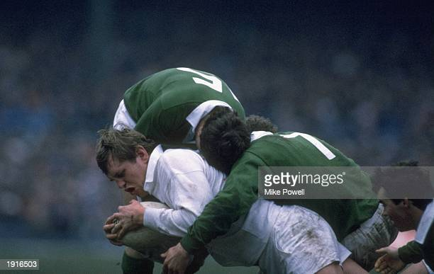 Dean Richards of England is tackled and brought down on his England debut during the Five Nations Championship match against Ireland at Twickenham in...