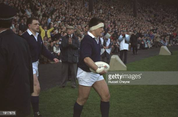 David Sole the Scotland Captain leads his team onto the field before the 1990 Five Nations Championship match between Scotland and England at...