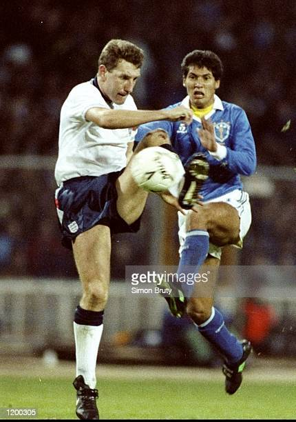 Terry Butcher of England and Bismarck of Brazil in action during a Friendly match at Wembley Stadium in London England won the match 10 Mandatory...