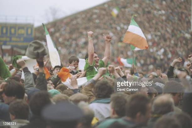 Ireland's hero Eric Elwood is held aloft after their historic victory during the Five Nations International between Ireland and England at Lansdowne...