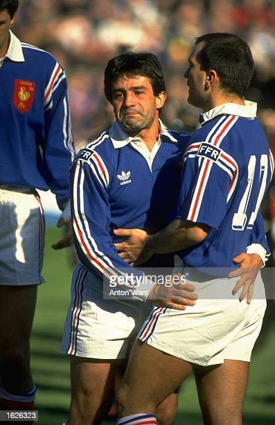 Alain Macabiav and Thierry Lacroix of France hug each other as French emotions run high during the Five Nations Championship match between Scotland...