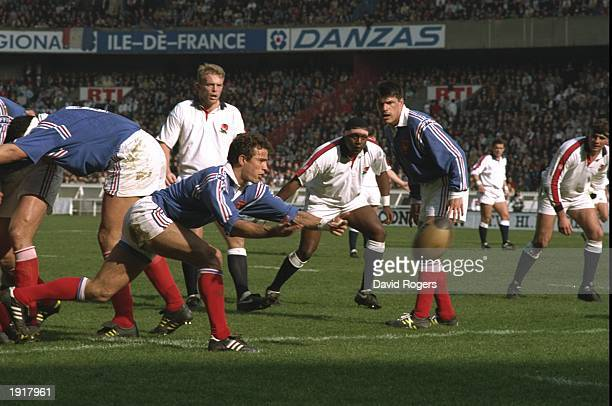 Fabien Galthie of France feeds back the ball during the 1994 Five Nations Championship match between France and England at the Parc des Princes in...