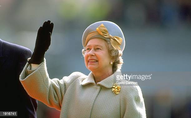 Her Majesty the Queen waves to the supporters after opening the new stand during the Five Nations Championship match between England and Wales at...