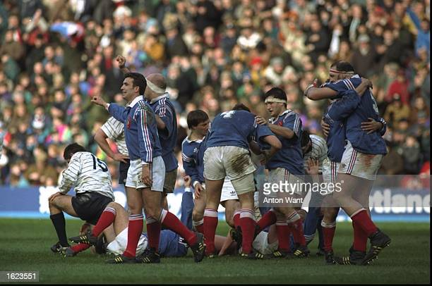 The French team celebrate as the final whistle blows in the Five Nations Championship match against Scotland at Murrayfield in Edinburgh Scotland...