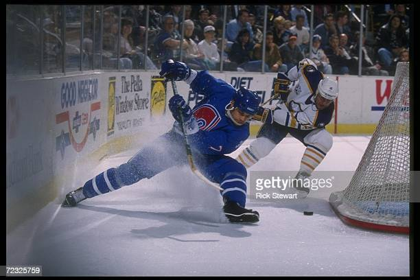 Defenseman Curtis Leschyshyn of the Quebec Nordiques goes for the puck during a game against the Buffalo Sabres at Memorial Auditorium in Buffalo New...
