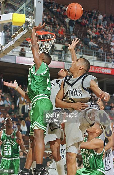 Allen Iverson of Georgetown blocks a shot by Anthony Davis of Mississippi Valley State as the Hoyas meet the Delta Devils in the first round of the...