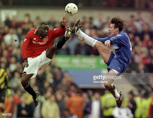 Andy Cole of Manchester United and Craig Burley of Chelsea jump for the ball during the FA Cup SemiFinal at Villa Park in Birmingham England...