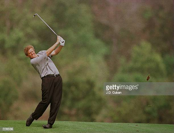 Colin Montgomerie of Great Britain hits his second shot on the 14th hole during the second round of the 1996 Players Championship at the TPC at...