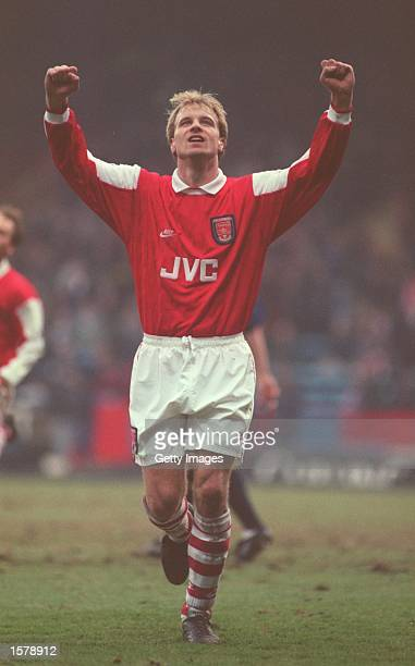 Dennis Bergkamp of Arsenal celebrates scoring Arsenal's third goal during the FA Premiership match between Wimbledon and Arsenal at Selhurst Park...