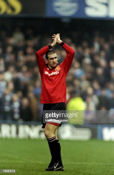 Eric Cantona of Manchester United applauds during an FA Carling Premiership match against Queens Park Rangers at Loftus Road in London Mandatory...