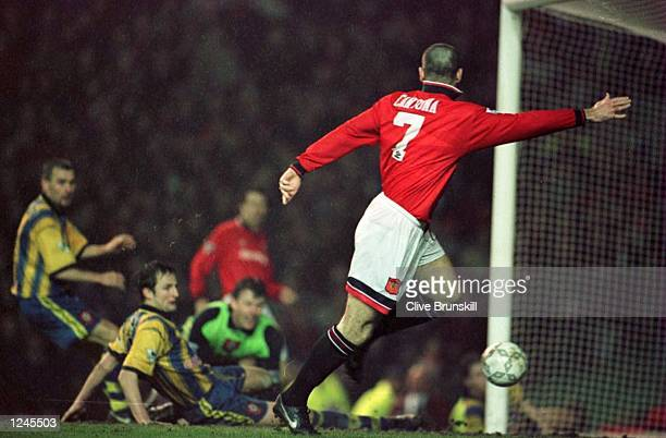 Eric Cantona scores the opening goal for Man Utd during the Manchester United v Southampton FA Cup Quarter Final Match at Old Trafford Manchester...