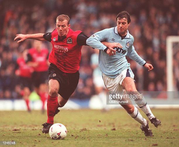 Goal scorer Alan Shearer of Blackburn is challenged by Kit Symons of Manchester City during the Carling FA Premiership match between Manchester City...