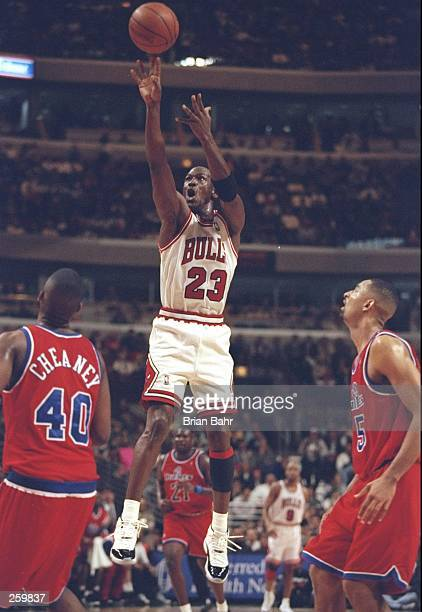 Guard Michael Jordan of the Chicago Bulls shoots the ball during a game against the Washington Bullets at the United Center in Chicago Illinois The...
