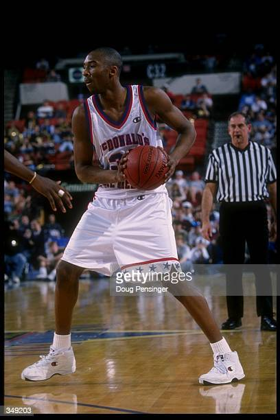 Kobe Bryant looks to pass the ball during the McDonald''s AllAmerican at the Civic Arena in Pittsburgh Pennsylvania Mandatory Credit Doug Pensinger...