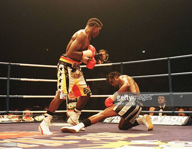 Nigel Benn is knocked down in the 12th round by Sugar Boy Malinga during the WBC super middleweight title fight at the Newcastle Arena tonight...