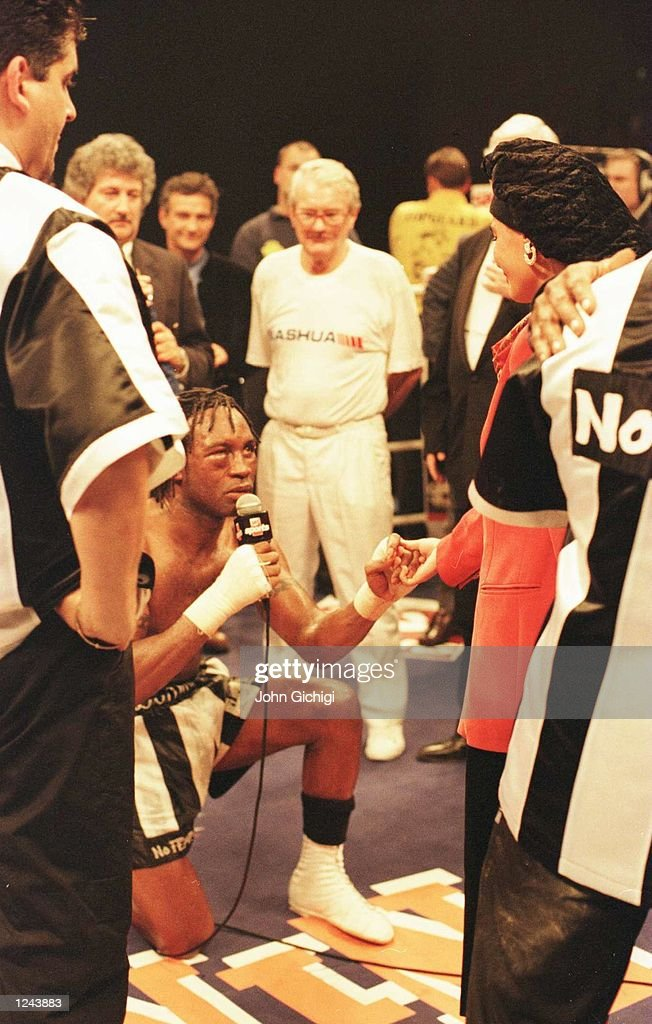 Nigel Benn proposes to Caroline Jackson after losing the WBC super middleweight title fight at the Newcastle Arena tonight. Mandatory Credit: John Gichigi/ALLSPORT